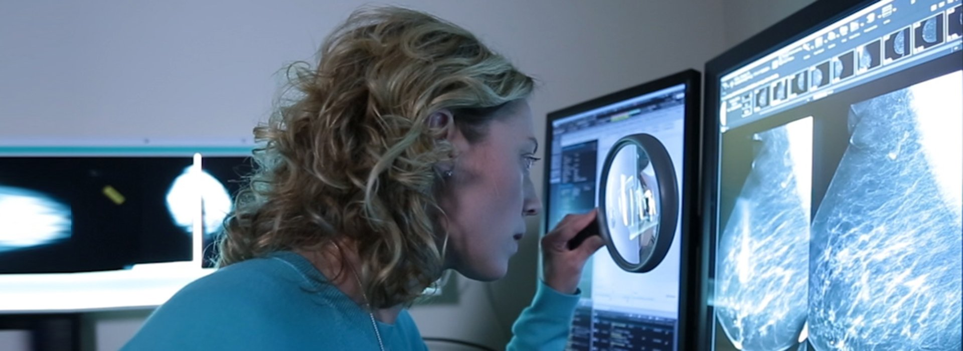 Doctor examining breast cancer scans.