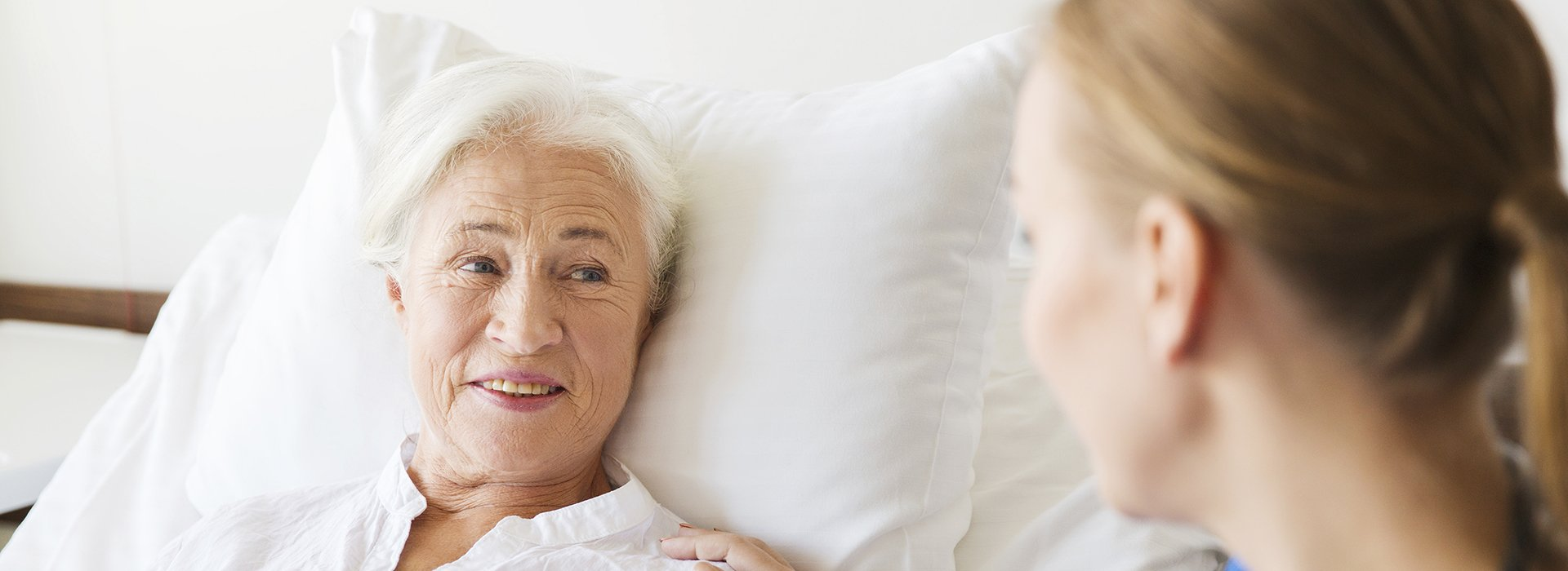Mature woman in hospital bed.