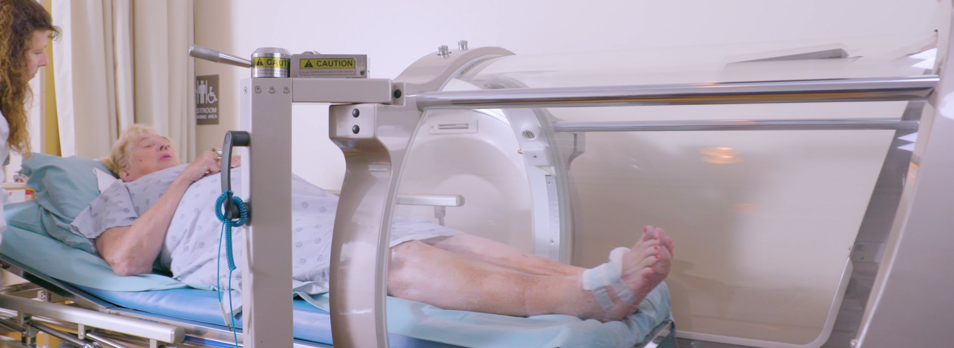 Woman receiving hyperbaric oxygen therapy.
