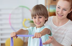 Child working with physical therapist