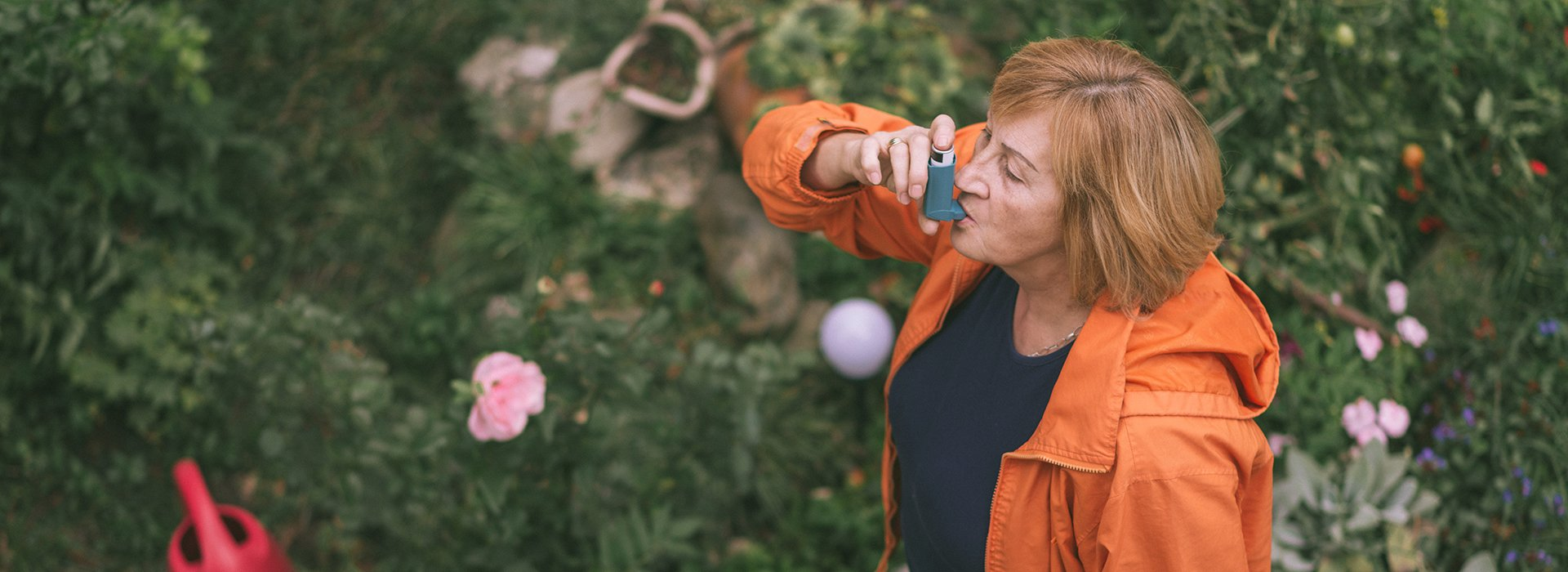 Woman using a rescue inhaler.